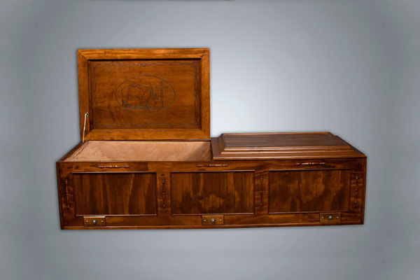 All stained casket with lid raises showing cowboy theme panel.